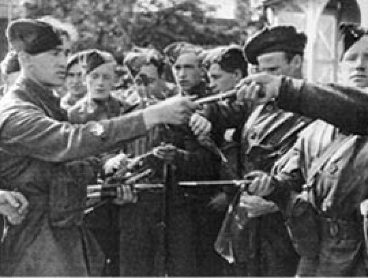 Commandos being issued with their fighting knives.
