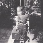 C /Sgt Bob 'Beau' Ghest carrying the radio set