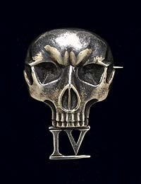 Deaths head cap badge designed by officers of No.4 Commando in 1940.