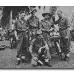 Dick Hawkins (standing 2nd left) and others