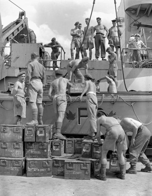 Commandos from No.2 loading ammunition on board LCA