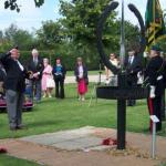 Patrick Higgins lays a cross to commemorate L/Cpl Eric Harden, VC., on behalf of Julie Wells
