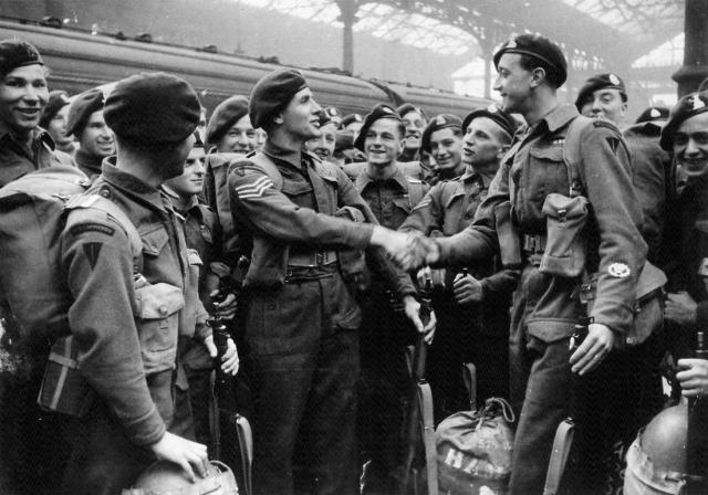TSM 'Lofty' Hampson 4 tp No.3 Cdo shaking hands with a Sgt.