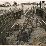 Commandos and Pioneer Corps, Beach Company, unload stores at Walcheren