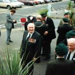 Henry Brown MBE in the centre, Bill Millin with bagpipes,  and others