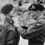 Marine Thomas Vardy 46RM Commando receiving his Military Medal from Montgomery