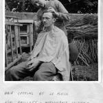 L/Cpl. Phillott cutting the hair of L/Cpl. 'Ken' Emmerson at le Plein