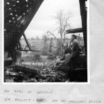 L/Cpl. Phillott , No.1  SS Bde. HQ Intelligence section amidst the ruins of Breville