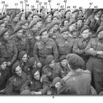 Men of No. 4 Commando being briefed before D-Day (numbered with names)