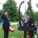 Brigadier Thomas laying The CVA Wreath