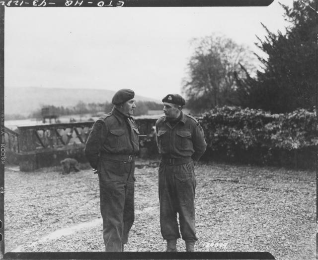Lt. Col. C.E. Vaughan, Commandant, confers with his 2 i/c, Major Cockcraft