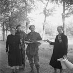 Two Dutch commandos being welcomed by Dutch women.