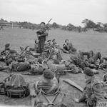 Piper Bill Millin entertains the men of 45 (RM) Commando, 1st Special Service Brigade