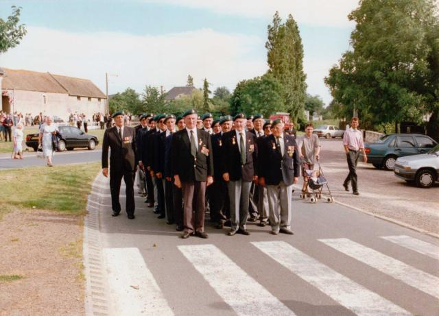 Veterans line up before marching to the 45RM Cdo memorial cross in Le Plein 6th June 1997