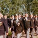 Veterans marching to the 45RM Cdo memorial cross in Le Plein 6th June 1997