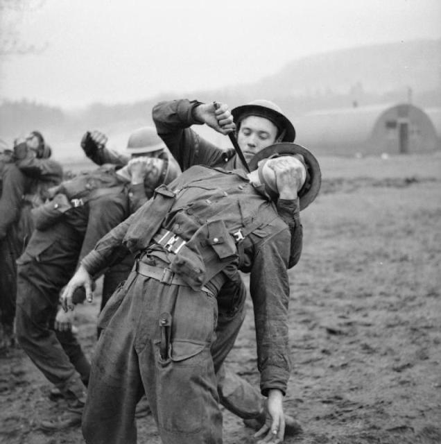 Commandos use fighting knives during close-quarter combat practice in Scotland, 9 Jan. 1943.