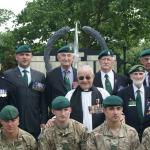 Green Berets past and present in front of the Army Commando Memorial