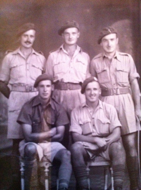 Sgt Harry 'Les' Hill (seated right) and others