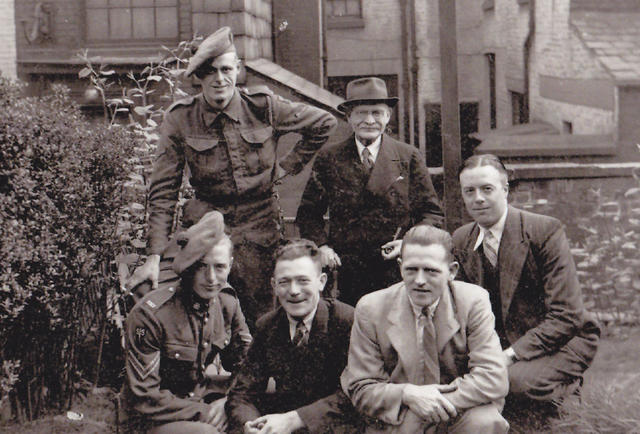 Cpl. Alex Mort No 2 Cdo and others on leave in Church Street, Bolton