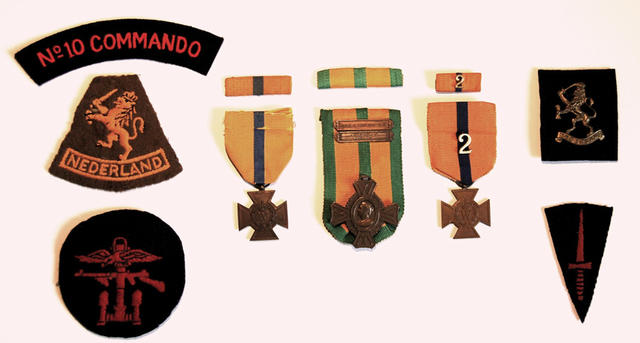 Medals of Albert Bloemink and insignia patches relating to his unit