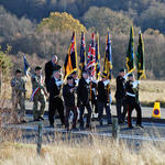 Colours marching to the Memorial at Spean Bridge