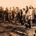 Group from 1 Troop, No 9 Cdo with local people at Strymon Bridge, Greece, November 1944