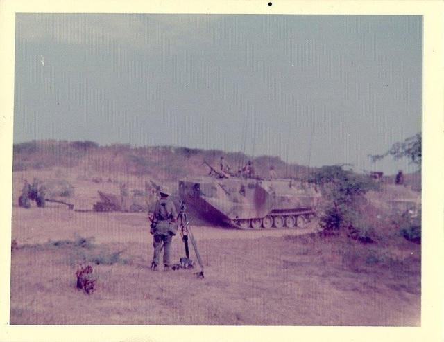 US Marines Amtrac going through 79 Commando Light Bty Gun Position