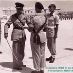 Corporal Dennis Earp receiving his MM, from the Brigadier in Malta 1958