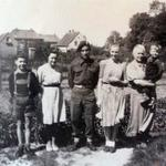 Roy Suzuki No 6 Cdo with a German family after liberating the village