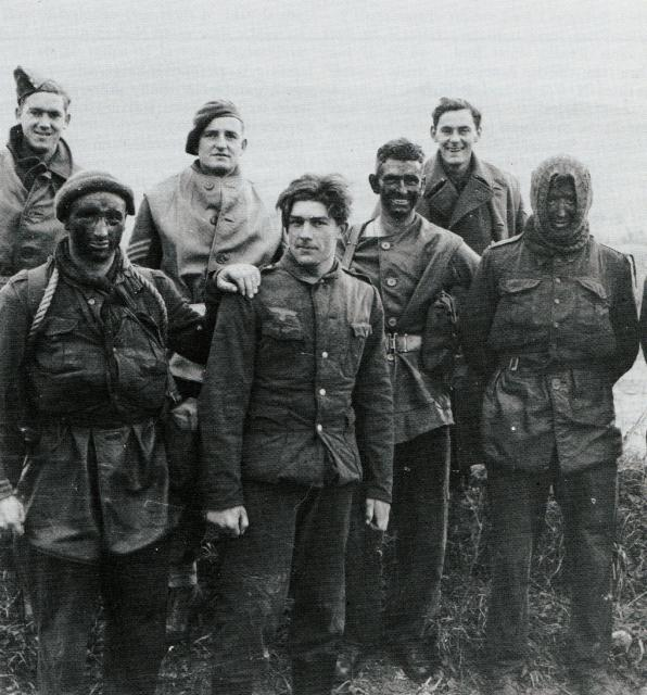 Men of 9 Commando, with a German prisoner, after their raid on the Garigliano Estuary defences, Dec 1943