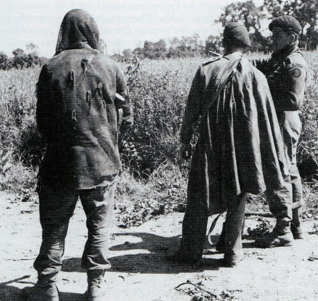 Col Peter Young briefs two snipers, Bernard Machin and Joe Leedham, in the Orne River area, 17th June 1944