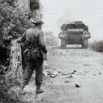 Lt Col Moulton, 48 RM Commando,directing the fire of tanks supporting the attack on Langrune strongpoint D+1, 7th June 1944