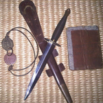Ronald Doughty's pay book, dog tags and Fighting Knife.