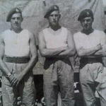Johnny Bolch (left), L/Cpl  Fred Carrington, and Tommy Mann (right)