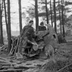 C/Sgt Gray, Sgt Harrison, and Mne Hedges, 45RM Cdo., with captured gun