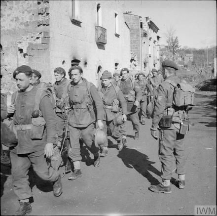 Belgian commandos parade in a village at the foot of Mt Camino, 6 February 1944.