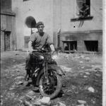 J MacGregor on motorcycle