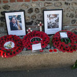 Wreaths and photos below the plaque to Pat Portoeus VC