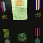 Medals and cap badge of LCpl. John Donaldson No 2 Commando