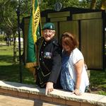 Fred Davies shows Anne George her father's paver