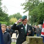 Roy Maxwell (No.4 Cdo.) at the memorial to No.4 Commando at Le Hauger Amfreville