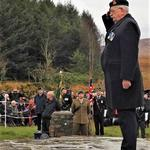 CVA Treasurer, John Burn lays a wreath