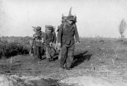 No. 2 Commandos with prisoners carrying equipment