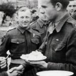 A decorated Polish Major greets a comrade.