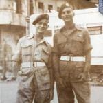 Cpl. J.J. O'Sullivan (left) and ?, 45 Commando, o/s the Fleet Club, Hong Kong Aug. 1946