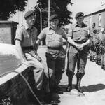 Cpl. Jack French, Sgt Wilkinson, and Cpl. Kennedy by the old water tank outside Brick Gym at CTCRM