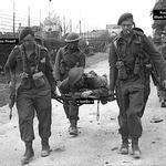 (A70 31-3) Joe Powell No.4 Cdo. and Jumbo on stretcher