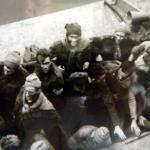 Close up photo of Commandos disembarking from their ALC after the St Vaast raid.