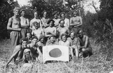 Group of No5 Cdo with captured Japanese Flag