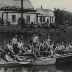 Thomas McGuinness and others in boats